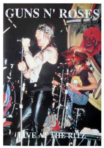 Guns N Rosesרובים ושושנים אקסל רוס Axl Rose סולן הופעה חיה רוק במה סקסי