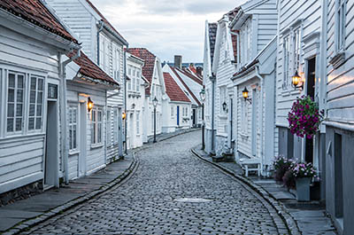 Curvy street with old nice white houses in historical center of Stavanger city, Norway -Curvy street with old nice white houses in historical center of Stavanger city, Norway -
